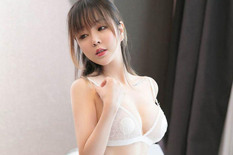 cute-asian-woman-in-white-bra-in-the-bedroom