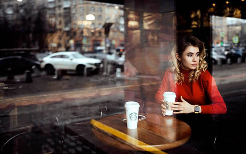 slavic-beauty-in-the-red-sweater-drinking-coffee